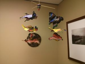 This mobile at the doctor's office is more pleasant to look at than Eric's sickly hue following his injections. :-/