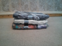 Vacuum packing larger items for suitcase space.