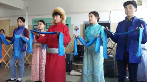 A mini presentation by even more of our students. The blue silk scarfs are honorary.