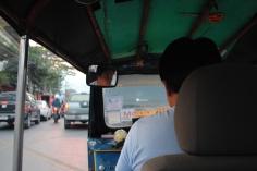 riding in a tuk-tuk