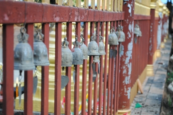 bells on the fence around the stupa